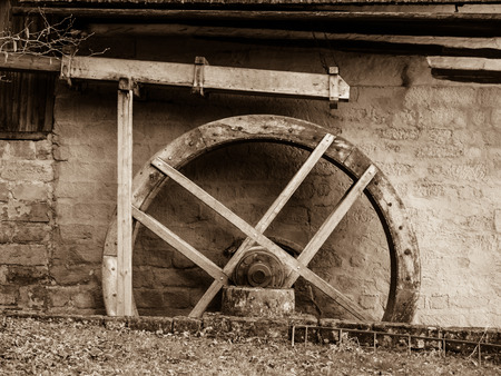 waterwheel: Old mill water wheel without water, no motion, sepia image