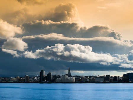 Reykjavik cityscape just before storm with dramatic clouds, Iceland photo