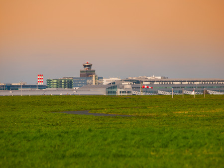 Airport panorama view at sunset time with air traffic control tower