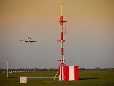 radio tower: Airport radio tower and land landing plane in
