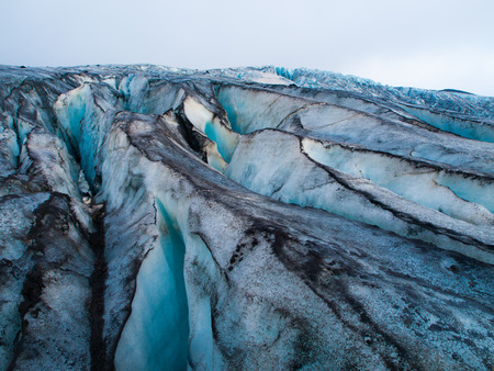 vivid: Detailed view of glacier structure with blue vivid colors and dirty ice, Iceland