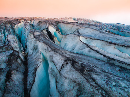 mud and snow: Detailed view of glacier structure with blue vivid colors and dirty ice, Iceland
