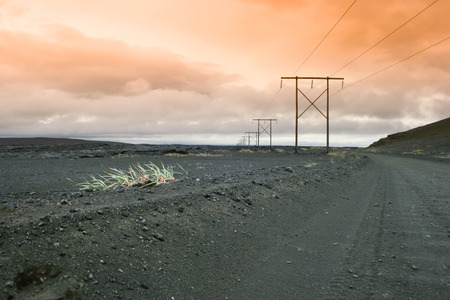 Icelnadic landscape with typical power lines before dawn