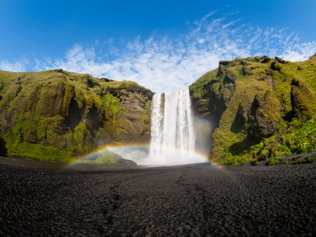 skogafoss waterfall: Skogafoss waterfall with rainbow on sunny summer day, Iceland