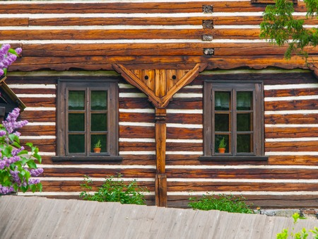timbered: Two windows of old timbered house, typical czech rural architecure