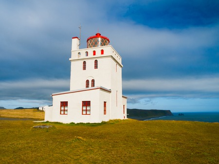 whithe: White lighthouse on the cape Dyrholaey, Southern Iceland