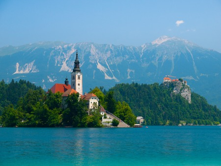 karawanks: Bled lake with island church and Bled castle, mountains in background, Slovenia