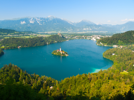 karawanks: Aerial view of Bled Lake with island church and Bled Castle, mountains in background, Slovenia