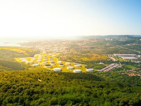 Oil tanks in industrial zone near Trieste, Italy Imagens - 42940661