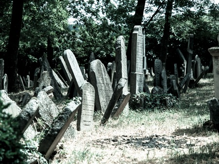 tombstones: Old tombstones in Jewish cemetery, Mikulov, Czech Republic, cold tone image Stock Photo