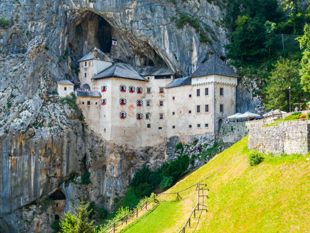 castle tower: Predjama Castle built in the cave, Slovenia Stock Photo