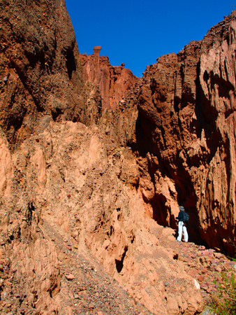 red rock: Woman standing at the end of red rock canyon, Tupiza, Bolivia Stock Photo