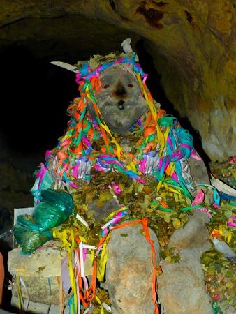 Figure of El Tio - the lord of underworld in silver mines of Cerro Rico in Potosi, Bolivia Banco de Imagens