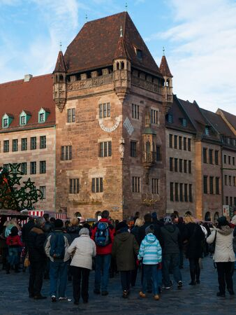bayern old town: Old tower of Nassau House - Nassauer Haus and many people in front of it, Nuremberg, Germany Stock Photo