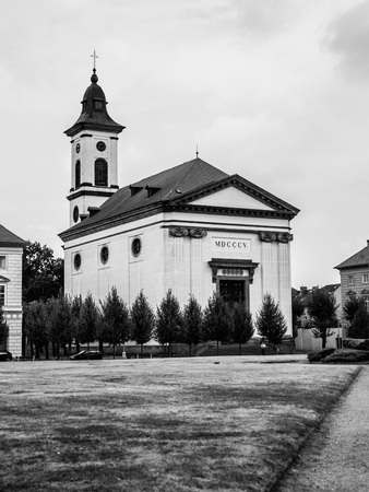 terezin: Baroque Church of Resurrection of Our Lord on Czechoslovak Army Square in Terezin, Czech Republic, black and white image