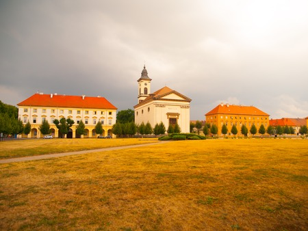 terezin: Czechoslovak Army Square with baroque church in Terezin fortress town, Czech Republic