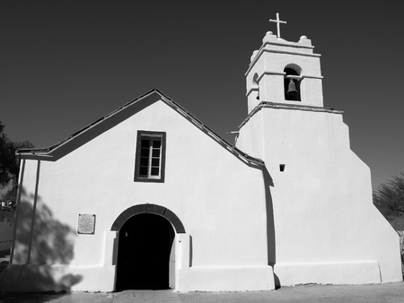 colonial church: Little white colonial church of St. Peter, San Pedro de Atacama, Chile. Black and white image.