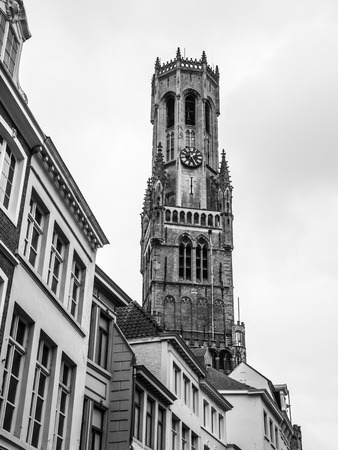 belfort: The Belfry Tower of Bruges, or Belfort, is medieval bell tower in the historical centre of Bruges, Belgium. Black and white image.