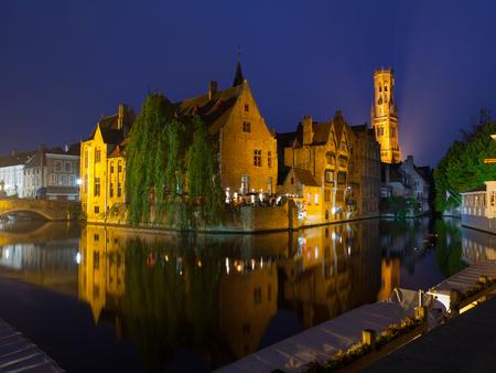 belfort: The dock of Rosary - Rozenhoedkaai - and Belfort Tower at night, Bruges, Belgium Stock Photo