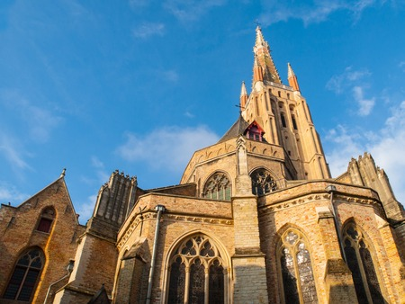 the church of our lady: Medieval Church of Our Lady in Bruges in sunny day, Belgium Stock Photo