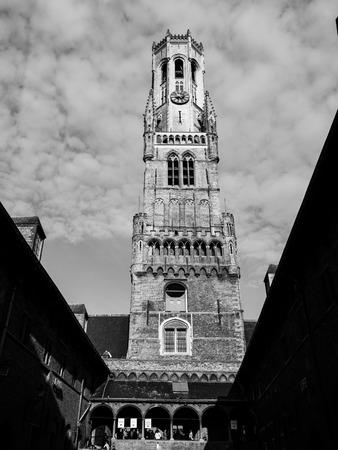belfort: The Belfry Tower of Bruges, or Belfort, is medieval bell tower in the historical centre of Bruges, Belgium. Black and white image.