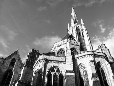 our lady: Medieval Church of Our Lady in Bruges in sunny day, Belgium. Black and white image