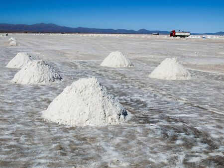 salar de uyuni: Salt piles on Salar de Uyuni where salt is produced, Bolivia Stock Photo