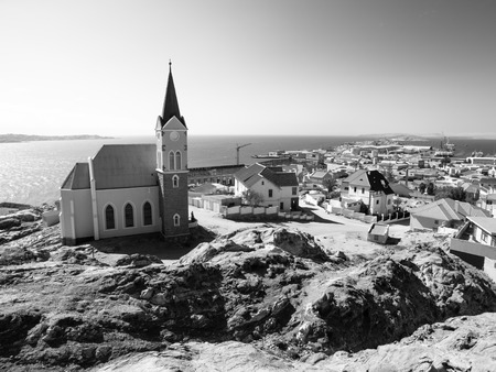 unique characteristics: German colonial church in namibian Luderitz, Namibia. Black and white image.