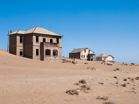 kolmanskop: Kolmanskop Ghost Town near old diamond mines in southern Namibia with devasted houses filled with sand. Stock Photo
