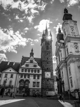 gildhall: Black Tower and Town Hall in Klatovy, Czech Republic. Black and white image. Stock Photo
