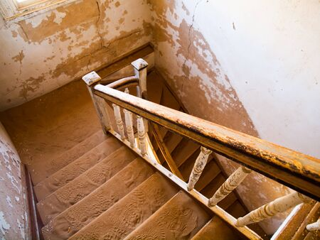 kolmannskuppe: Old staircase in abandoned house filled with sand, Kolmanskop Ghost Town, Namibia