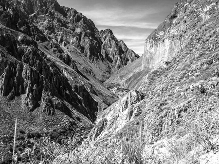 the deepest: View of the deepest parts of Colca Canyon near Cabanaconde in Peru. Black and white image.