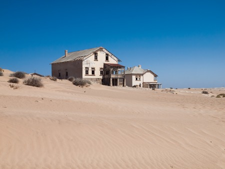 Kolmanskop Ghost Town near old diamond mines in southern Namibia with devasted houses filled with sand. Imagens