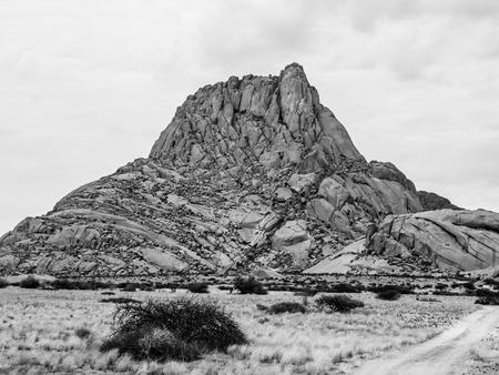 spitzkoppe: Spitzkoppe mountain - bald granite peak in Namibia. Black and white image.