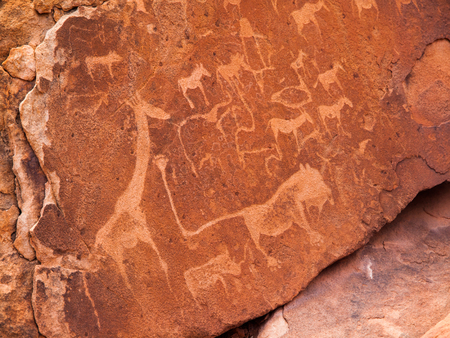 Prehistoric Bushman engravings - Lion Plate with Lion Man and other animals and symbols, Twyfelfontein, Namibia