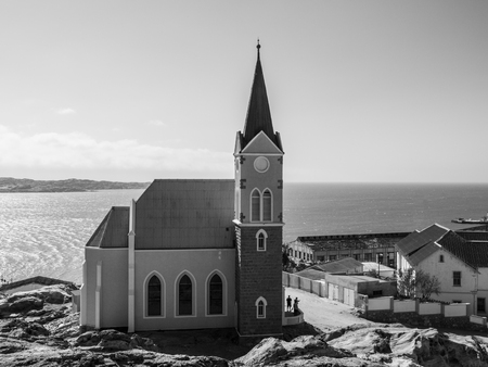 luderitz: German colonial church in namibian Luderitz, Namibia. Black and white image.