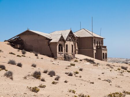 kolmannskuppe: Kolmanskop Ghost Town near old diamond mines in southern Namibia with devasted houses filled with sand. Stock Photo
