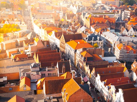 medieval: Aerial view of narrow streets and red rooftops of Bruges, Belgium