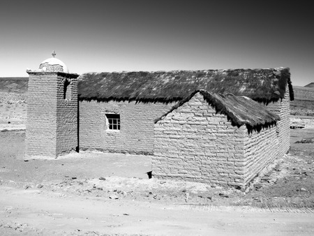 lipez: Small rural andean style church made of unfired clay bricks, Cordillera de Lipez, Bolivia. Black and white image. Stock Photo