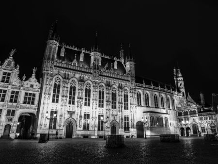 burg: Burg square with the City Hall by night, Bruges, Belgium. Black and white image.