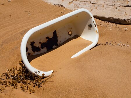 overturn: Old white bath in the sand, Kolmanskop, Namibia Stock Photo