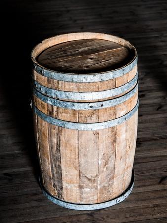 wooden barrel: Old wooden barrel standing on the wooden floor Stock Photo