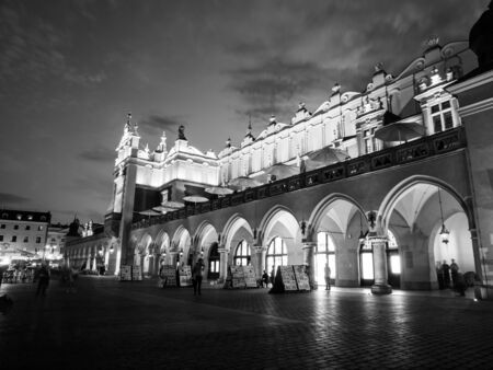 main market: Cloth Hall, or Sukiennice, on Main Market Square in the Old Town by night, Krakow, Poland. Black and white image.