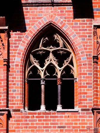 gothic window: Brick vintage window in gothic architectural style
