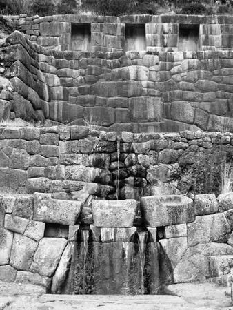 inca architecture: Incan spa and spring Tambo Machay near Cusco, Peru. Detailed view of spring and stone architecture. Black and white image.