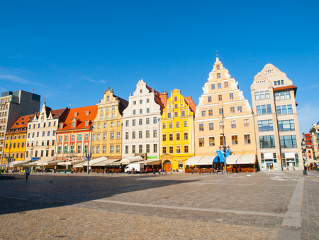 silesia: WROCLAW, POLAND - CIRCA 2014: Typical colorful houses on Market square in Wroclaw, Poland. Wroclaw is the capital of Silesia and Lower Silesia. Editorial