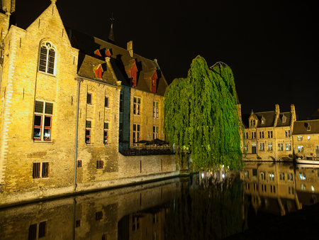 mediaeval: Picturesque canal at Rozenhoedkaai, or Rosary Quay, and mediaeval archutecture of Bruges by night, Belgium