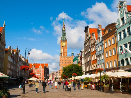apartment tower old town: GDANSK, POLAND - CIRCA AUGUST 2014: Many tourists on Long Market, or Dlugi Targ, with Town Hall on sunny day in Old Town of Gdansk, Poland.
