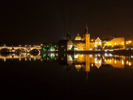vltava river: Vltava River with Charles Bridge, Mlynec and Old Town Water Tower by night, Prague, Czech Republic Stock Photo