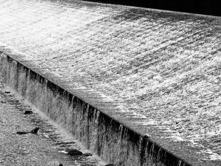 short wave: Detailed view of weir on the river. Black and white image. Stock Photo